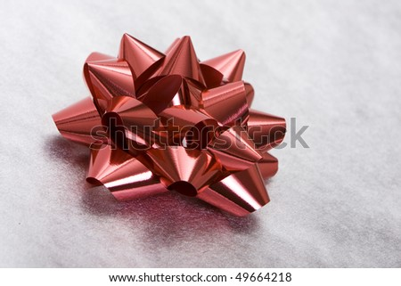 Red bow on a beautifully wrapped gift