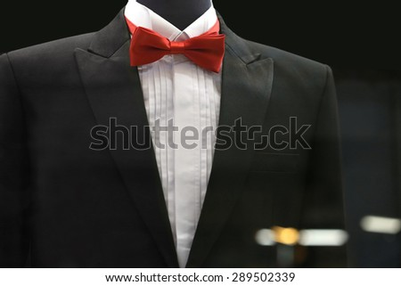 red bow tie with black suit - stock photo