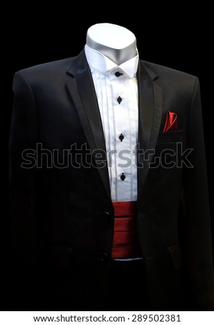 red bow tie with black suit ,Tailor concept. Businessman getting measured by a tailor