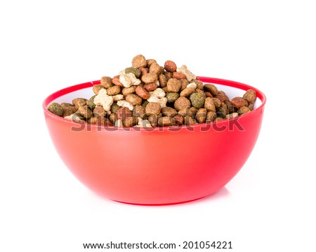 Red bowl full of dog food shot on white