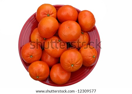 Red bowl of Clementines, a sweet and mostly seedless citrus fruit