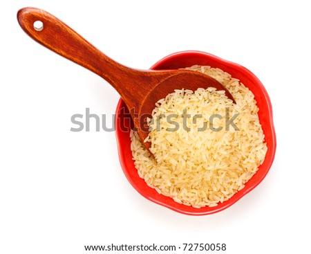 red bowl with rice and wooden spoon - stock photo