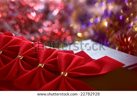 red bows over holiday background
