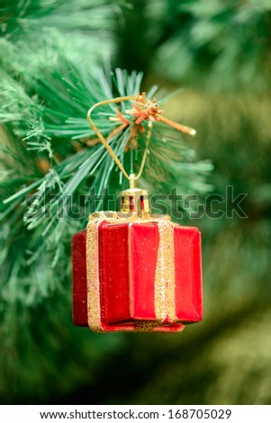 red box gift toy decorations on Christmas tree. new year - stock photo