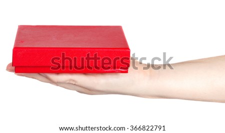 red box in a female hand on a white background