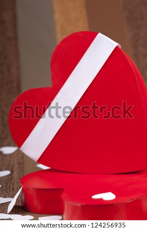 Red box in heart shape on an artistic background macro studio shot
