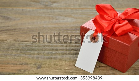 Red box on a wooden background, Valentine's Day concept - stock photo