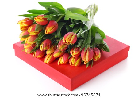 Red box with bouquet of tulips on white isolated background - stock photo