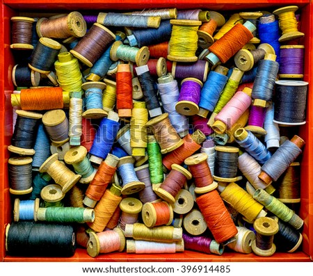 Red box with colored threads for sewing HDR effect - stock photo