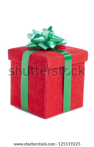 Red box with green ribbon isolated on - stock photo