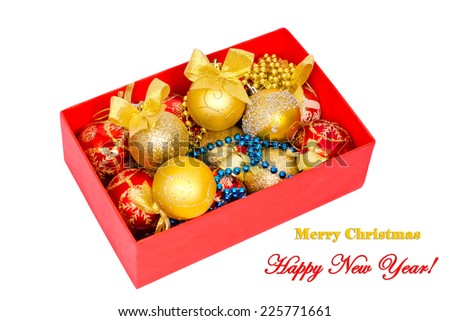 Red box with lots of Christmas decorations for the Christmas tree isolated on white background  - stock photo