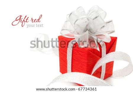 Red box with silver ribbon on white background. Copy-space - stock photo