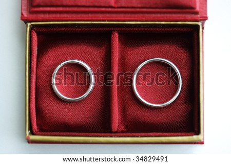 Red box with two Wedding rings - view from above - stock photo