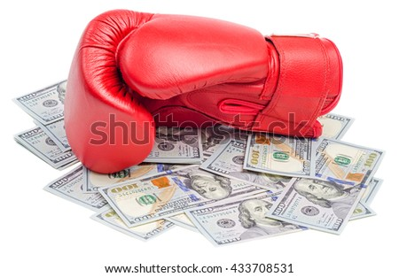 Red boxing glove on top of dollars bills isolated on white background - stock photo