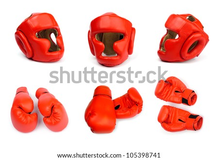 Red boxing gloves and helmets on white background - stock photo