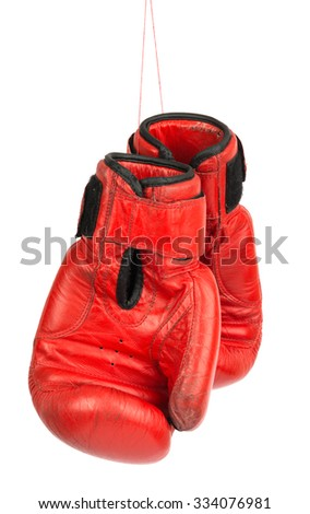 Red boxing gloves on isolated white background