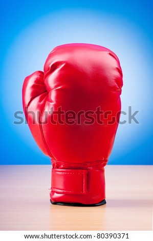 Red boxing gloves on the background - stock photo