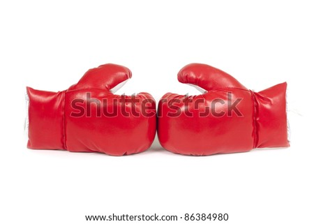 Red boxing leather gloves isolated on white. - stock photo