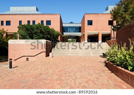 Red brick building on campus - stock photo