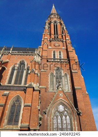 red brick church and blue sky in Osijek Croatia - stock photo