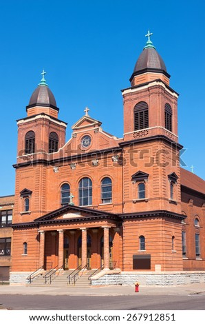 Red brick church exterior facade and stairs of beaux arts architectural style in saint paul minnesota  - stock photo