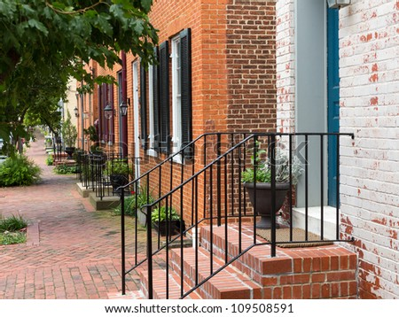 Red brick georgian houses in Frederick Maryland on historic street - stock photo