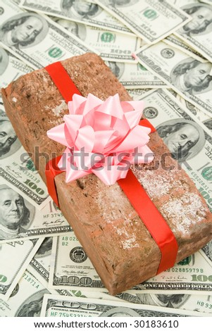 Red Brick Gift and dollars, Concept of joke, make fun of somebody, gift on April Fool's Day, Prank gift