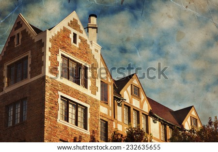 Red brick house on the blue sky background, English style house - stock photo