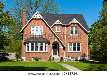 Red brick house with a bay window