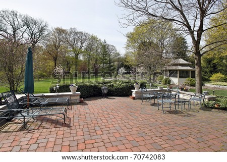 Red brick patio in spring with gazebo - stock photo