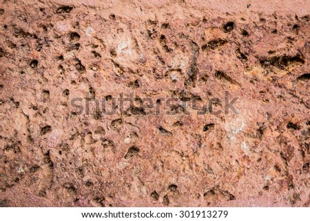 Red brick texture macro closeup, old detailed rough grunge textured copy space background, vertical grungy weathered stained vintage cracked backstein brickwork cut pattern - stock photo