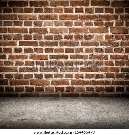 Red brick wall and brick floor interior background  - stock photo