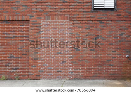 red brick wall and sidewalk