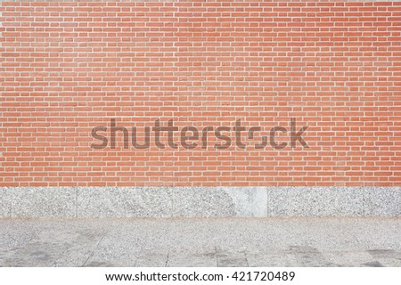Red brick wall and stone tiled floor background