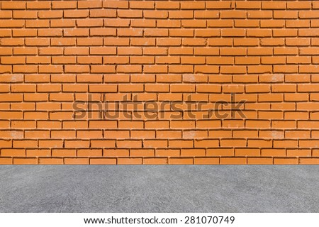 Red brick wall and white concrete floor.