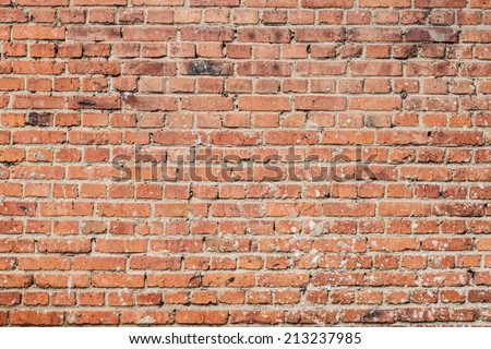 Red brick wall background close up - stock photo