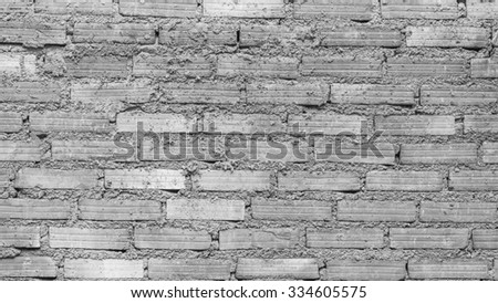 Red brick wall background pattern in black and white. - stock photo