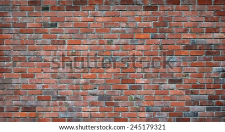 Red brick wall background. Wall is 5 x 2 metres and made of reclaimed bricks with lots of character. Ideal urban pop or fashion background. Also good background for sign or street name. - stock photo