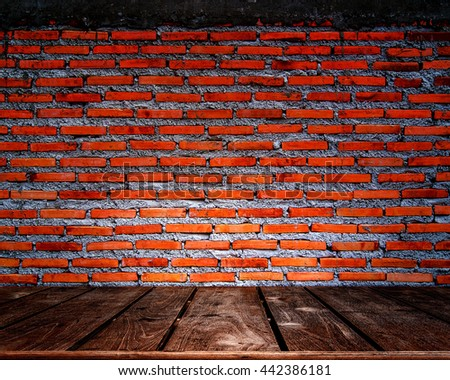 Red brick wall background with wood floor - stock photo