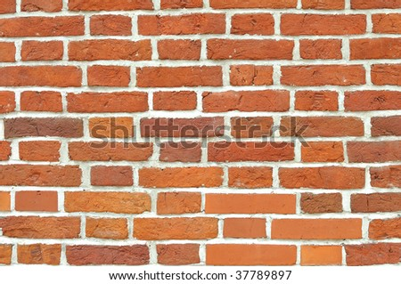 Red brick wall built of different stones. Can be used as background - stock photo