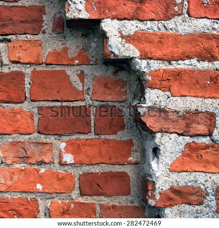 Red brick wall close-up - stock photo