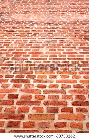 Red brick wall closeup pattern - stock photo