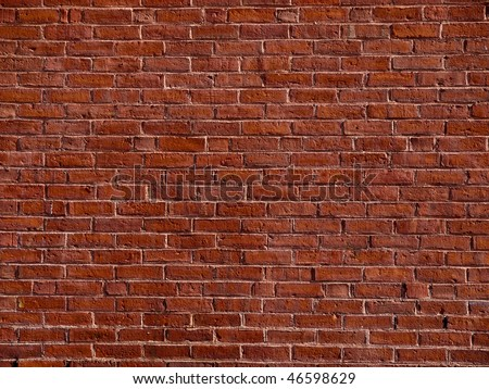 Red brick wall from a turn of the century textile mill. - stock photo