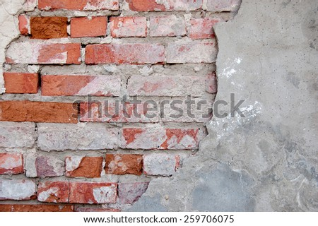 Red brick wall half covered with gray cement a lot of copyspace, blank place for text - stock photo