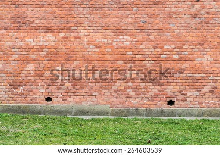 Red brick wall on a stone foundation