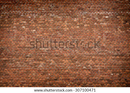 red brick wall texture grunge background with vignetted corners, may use to interior design - stock photo