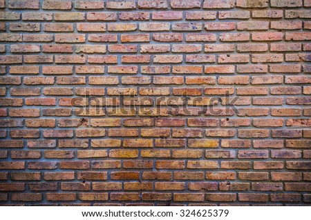 red brick wall texture grunge background with vignetted corners of image. - stock photo