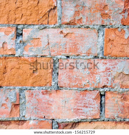 Red brick wall texture macro closeup, old detailed rough grunge cracked textured bricks copy space background, grungy weathered stained vintage brickwork cut vertical pattern - stock photo