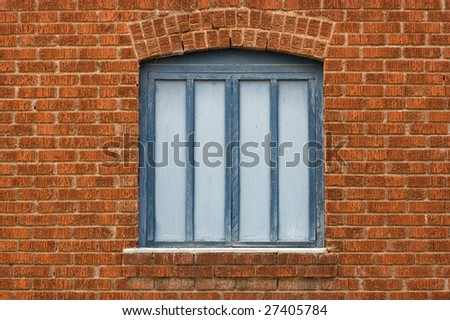 Red brick wall with blue wood window - stock photo