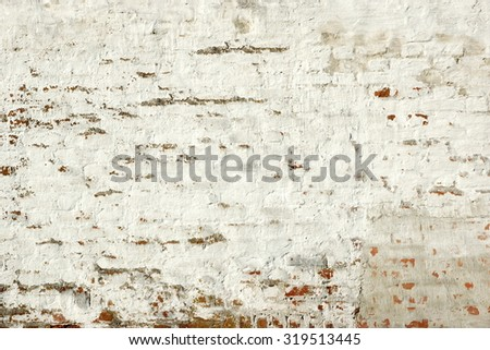 Red Brick Wall With Damaged And Cracked White Plaster Background Texture - stock photo